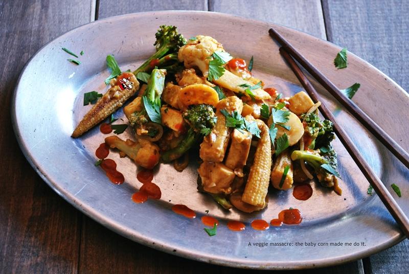 Cauliflower and broccoli stir-fry with tofu + sriracha-spiked peanut sauce