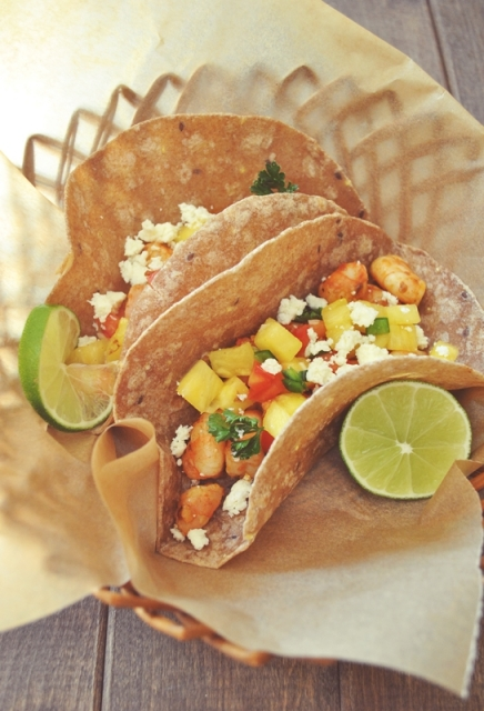 Chipotle shrimp tacos with pineapple-jalapeno salsa + cotija cheese