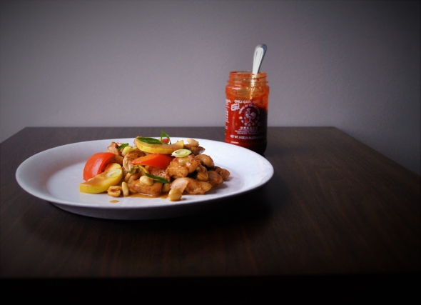 Chicken stir-fry with yellow squash, red bell pepper, peanuts, and chili garlic-coconut sauce