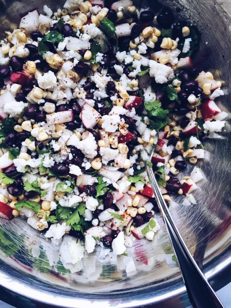 Black bean, radish, corn salad with cotija cheese and lime-cilantro dressing