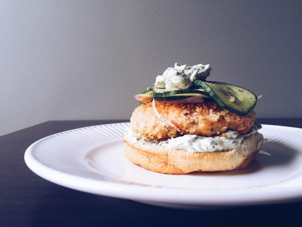 crunchy smoked salmon burger, whipped dill cream cheese, cucumber-shallot relish, onion hamburger bun