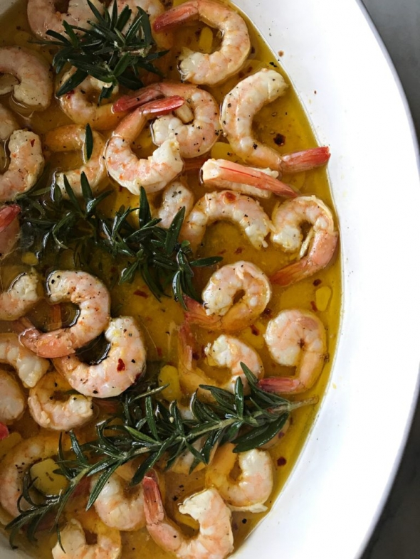 Olive oil and rosemary-poached shrimp with garlic, anchovies, and red pepper flakes